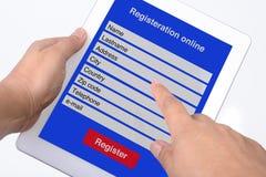 Registrazione online dalla compressa. Fotografia Stock