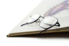 Registre e um par de vidros Imagens de Stock Royalty Free
