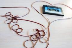 Registreringsapparatkassetten från de 90th lögnerna i hjärta från ett magnetiskt band royaltyfri foto