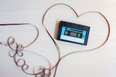 Registreringsapparatkassetten från de 90th lögnerna i hjärta från ett magnetiskt band royaltyfria foton