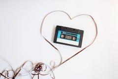 Registreringsapparatkassetten från de 90th lögnerna i hjärta från ett magnetiskt band royaltyfri fotografi