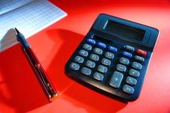 Registro de la calculadora y de la batería del talonario de cheques Imagen de archivo