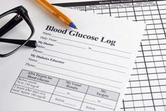 Registro de la glucosa en sangre imagen de archivo