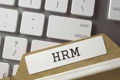 Registro della cartella con l'iscrizione HRM 3d Fotografie Stock