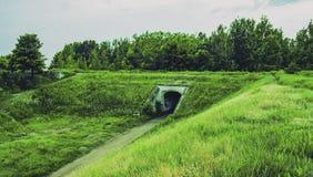 Registro en el túnel Debajo de la montaña en el llano Foto de archivo