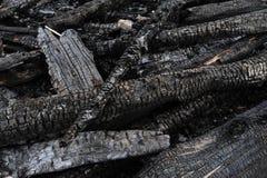 Registros de madera quemados Imagenes de archivo