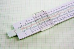 Regla de diapositiva en el papel ajustado Imagen de archivo libre de regalías