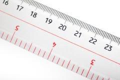 Regla para las pulgadas, el centímetro, y el milímetro fotografía de archivo libre de regalías