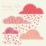 Regn av hjärta med moln i rosa färger Arkivbild