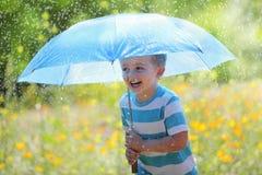 Regn och solsken Arkivfoton