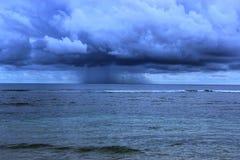 Regn på mitt av havet royaltyfri foto