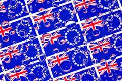 Regn tappar mycket av kockIslands flaggor royaltyfri bild