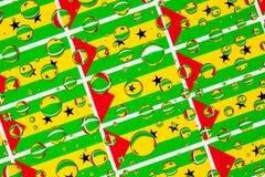 Regn tappar mycket av São Tomé och Príncipe flaggor royaltyfria foton