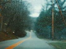 Regn till och med exponeringsglaset Arkivfoto