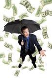 regna för pengar Arkivbild