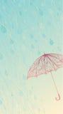 Regna och paraplyet Royaltyfri Foto