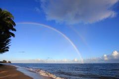 Regnbåge över hav Fotografering för Bildbyråer