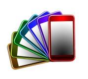 Regnbåge av kulöra mobiltelefoner Arkivbilder