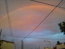 Regnbåge i skyen arkivfoto