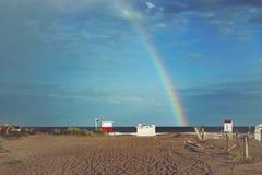 Regnbåge i stranden Fotografering för Bildbyråer