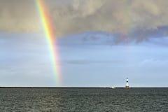 Regnbåge och Conneaut ljus arkivbilder