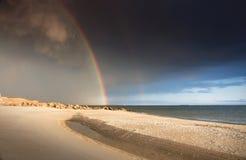 Regnbåge på havet fotografering för bildbyråer