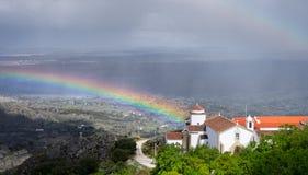 Regnbåge, regn och kyrka Royaltyfria Foton