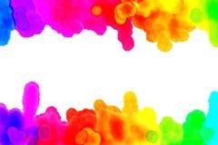 Regnbågeakvarellen dryper & bläckar ner royaltyfri foto