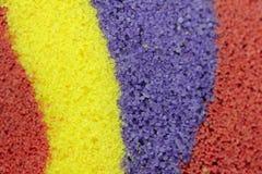 Regnbågeremsor av kulör sand arkivfoto