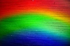 Regnbågesandbakgrund Arkivfoto