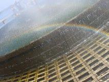 Regnbåge i springbrunn Royaltyfri Bild