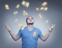 Regnen des Geldes stockbilder