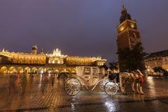 Regnig afton i Krakow royaltyfria foton