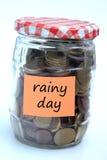 regniga besparingar för dag Arkivbild