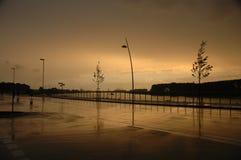 regnsolnedgång Fotografering för Bildbyråer