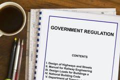 Regolamentazioni del governo e codice immagine stock