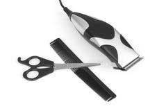 Regolatore, forbici e pettine elettrici dei capelli Fotografie Stock