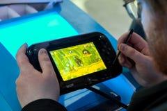 Regolatore nero della Nintendo WiiU Fotografia Stock Libera da Diritti