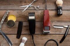 Regolatori e cera elettrici dei capelli fotografie stock