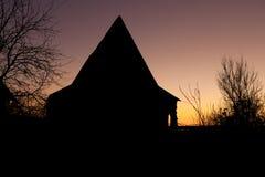 Regolazione di alba con la siluetta Fotografie Stock Libere da Diritti