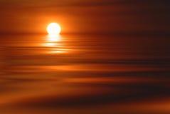 Regolazione di Sun con le nubi Immagine Stock