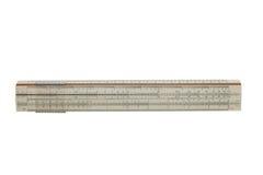 Regolo calcolatore da 25 centimetri su un fondo isolato Fotografia Stock
