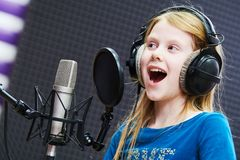 Regording studio. Child girl singing or role voicing Stock Image