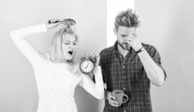 Regret late regime. Couple morning awakening alarm clock. Create healthy rest regime to sleep enough. We should go to. Bed earlier. Woman and men sleepy tousled royalty free stock photography