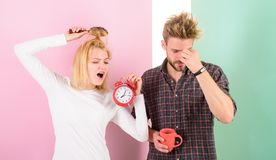 Regret late regime. Couple morning awakening alarm clock. Create healthy rest regime to sleep enough. We should go to. Bed earlier. Woman and men sleepy tousled royalty free stock image