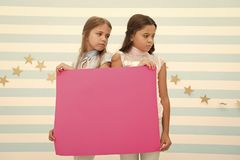Regret to inform you. Girls hold advertisement poster copy space. Children hold advertising banner. Sad kids with blank. Paper advertisement. Advertisement stock photography