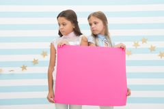 Regret to inform you. Girls hold advertisement poster copy space. Children hold advertising banner. Sad kids with blank. Paper advertisement. Advertisement stock photo