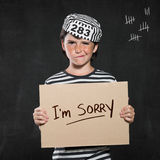 Regretful bad little boy Stock Photography
