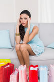 Regretful brunette with many shopping bags Stock Photography