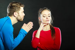 Regretful man husband apologizing woman wife. Husband apologizing wife. Man asking women for forgivness. Boyfriend trying to convince girlfriend. Conflicted Stock Photo